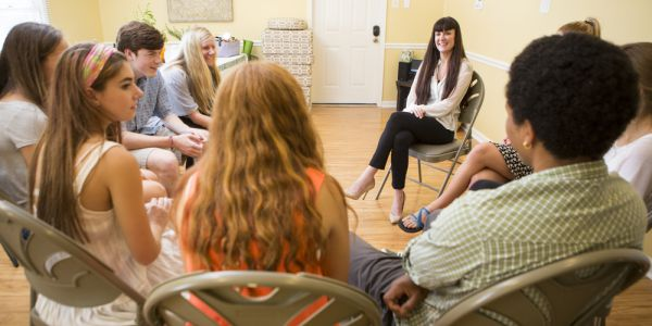 Teens meeting with counselor